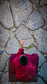 Alex, Adams, Outdoors, Day, Elevated View, Full Length, Gesturing, Sitting, Black Hair, Short Hair, Men, One Person, Traditional Culture, Religion, Buddhism, Pattern, Traditional Clothing, Individuality, Mystery, Spirituality, Pointing, Tibet, Monk-Religi