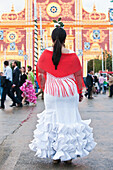 Paul, Quayle, Outdoors, Day, Rear View, Full Length, Walking, Incidental People, Women, One Person, Sunlight, Architecture, Built Structure, Street, Travel Destinations, Traditional Culture, Flower, Traditional Clothing, Traditional Festival, Seville, And