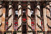 Rows of columns wrapped with garland decoration, Edinburgh, Scotland, United Kingdom