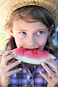 Young girl eating a slice of watermelon, Langley british columbia canada