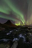 Northern lights (aurora borealis) over kirkjufell in the town of Grundarfjorthur, Snaefellsness Peninsula, Grundarfjorthur, Iceland