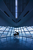 A grand piano in the corner of a room of glass walls overlooking the water, Milwaukee, Wisconsin, United States of America