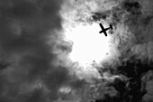 Airplane Silhouette Against Dramatic Sky, Low Angle View