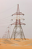 Electricity pylons in dessert, Abu Dhabi, United Arab Emirates