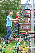 Father and son (7 years) on a climbing frame, Styria, Austria