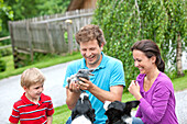 Family with a rabbit and dogs, Styria, Austria