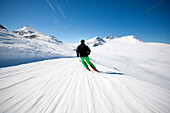 Skier downhill skiing, Laax, Canton of Grisons, Switzerland