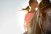 Teenage girl riding a horse, Morocco