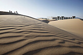 View over sand dunes to a hotel, Agadir, Morocco