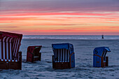 Beach and beach chairs at sunset, Juist Island, Nationalpark, North Sea, East Frisian Islands, East Frisia, Lower Saxony, Germany, Europe