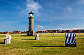 Lighthouse and beach chairs, Juist Island, Nationalpark, North Sea, East Frisian Islands, East Frisia, Lower Saxony, Germany, Europe