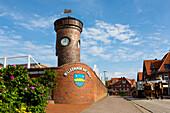 Small lighthouse with emblem, Juist Island, Nationalpark, North Sea, East Frisian Islands, East Frisia, Lower Saxony, Germany, Europe
