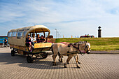 Horse and cart near a lighthouse, Juist Island, Nationalpark, North Sea, East Frisian Islands, East Frisia, Lower Saxony, Germany, Europe