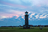 Colourful clouds over the lighthouse at Juist harbour, Juist Island, Nationalpark, North Sea, East Frisian Islands, East Frisia, Lower Saxony, Germany, Europe