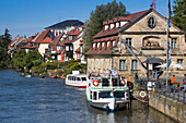 Sightseeing boat Christl and buildings of Klein Venedig (Little Venice) district alongside the left branch of the Regnitz river, Bamberg, Franconia, Bavaria, Germany