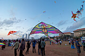 Visitors with kites in the evening on Galle Face Green, Colombo, Sri Lanka, South Asia