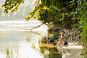Two young women at river Rhine, Rheinfelden, Baden-Wuerttemberg, Germany