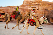 Men riding on a camel and a donkey, Petra, Jordan, Middle East