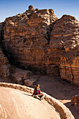 Woman on the roof of Ad Deir, Petra, Jordan, Middle East