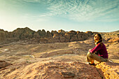 Woman sitting on a stone, Petra, Wadi Musa, Jordan, Middle East