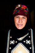 Portrait of a Bedouin woman wearing traditional costume, Wadi Rum, Jordan, Middle East