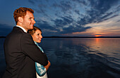 bridal couple is looking in sunset, Starnberger See, Bavaria, Germany