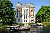 Boats in front of an old town house on the Stadhouderskade, Amsterdam, Holland