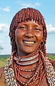 Turmi Ethiopia Africa village Lower Omo Valley Hamar Hammer tribe portrait of woman in village at sunset with First Wife necklace 24