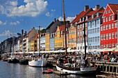 Nyhavn is a colourful 17th century waterfront, canal and popular entertainment district in Copenhagen, Denmark  Stretching from Kongens Nytorv to the harbourfront just south of the Royal Playhouse, it is lined by brightly coloured 17th and early 18th cent