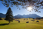 Mountain pasture with farms and hay barns in front of the Karwendel mountains, near Mittenwald, Bavaria, Germany