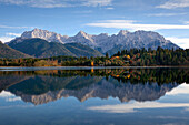 Karwendel mountains reflecting in lake Barmsee, near Mittenwald, Bavaria, Germany