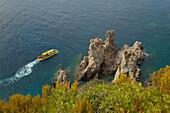 Submarine for tourists exploring the underwater landscape along the rocky coast of Paleokastritsa Bay, Corfu island, Ionian islands, Greece