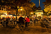 Pavement cafes in Place du Marchee, Le Perron in background, Liege, Wallonia, Belgium