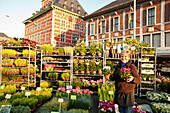 Female flower seller at La Batte market, Curtius Museum im background, Liege, Wallonia, Belgium