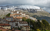 Village of Castelluccio, Piano Grande, Monte Vettore (2478m), mountain with snow, Monti Sibillini, Apennine Mountains, near Norcia, province of Perugia, Umbria, Italy, Europe