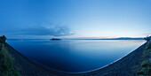 Crater lake Lago di Bolsena with Isola Martana at dawn, volcanic origin, near Montefiascone, province of Viterbo, Lazio, Italy, Europe