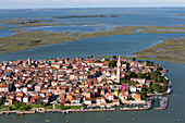 Aerial view of the Venetian Lagoon with salt marshes, Island of Burano, Fishing village with colourful house facades, Veneto, Italy