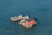 Aerial view of islands in the Venetian lagoon, Fishing huts on stilts, Pellestrina, Mediterranian Sea, Veneto, Italy