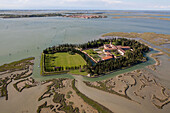 Aerial view of islands in the Venetian lagoon, Island of San Francesco del deserto with salt marshes, Burano in the background, Veneto, Italy