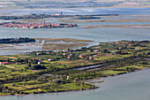 Aerial view of islands in the Venetian lagoon, Island of Sant' Erasmo with Burano and Torcello in the background, Veneto, Italy