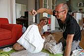 Paediatrician weighing a new born baby, Leipzig, Saxony, Germany