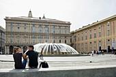 Piazza de Ferrari with fountain, Palazzo Ducale (palace of the doges) in background, Genoa, Liguria, Italia