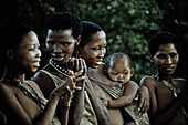 Four women and a baby of the San tribe, Otjozondjupa region, Namibia, Africa