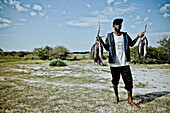 Fisher and his catch, Kunene region, Namibia, Africa