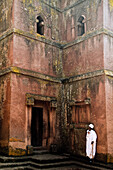 Religious man in front of the church of St. George, Lalibela, Ethiopia, Africa
