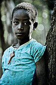 Young woman from the Konzo tribe leaning against a tree, South Ethiopia, Africa