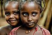 Two young girls from the Ari tribe, Jinka, South Ethiopia, Africa
