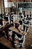 Children and teacher in a Massai village school, Kenya, Africa