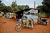 Taxi driver with his motorcycle taxi, Market street in Buwenda, Uganda, Africa