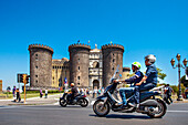 Scooters in front of Castel Nuovo, Naples, Bay of Naples, Campania, Italy
